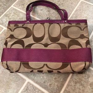 Small mauve and tan COACH handbag